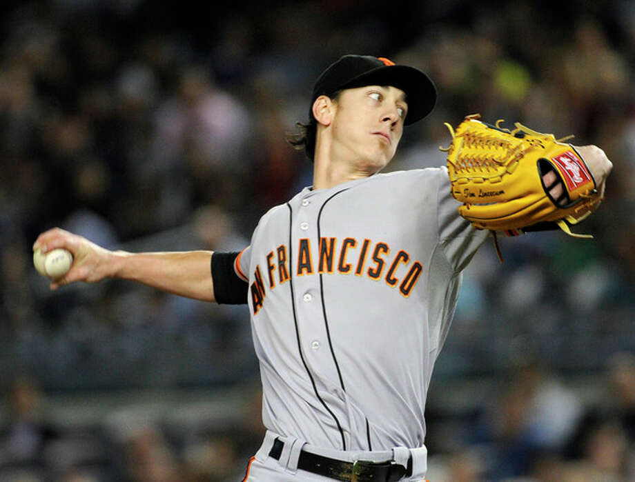 San Francisco Giants pitcher Tim Lincecum delivers the ball during the first inning of an interleague baseball game against the New York Yankees, Friday, Sept. 20, 2013, at Yankee Stadium in New York. (AP Photo/Bill Kostroun) / FR51951 AP