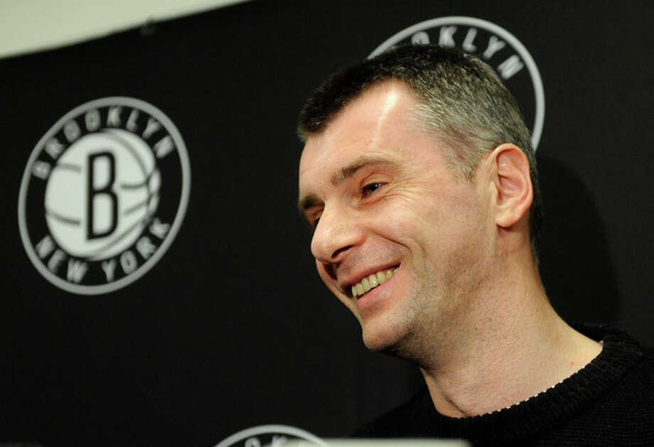 Brooklyn Nets principal owner Mikhail Prokhorov smiles as he speaks to the media concerning the firing of head coach Avery Johnson. Prokhorov spoke at half time of an NBA basketball game against the Charlotte Bobcats on Friday, Dec., 28, 2012 at Barclays Center in New York. (AP Photo/Kathy Kmonicek) / FR170189 AP