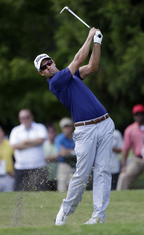 Adam Scott, of Australia, hits from the second tee during the second round of play in the Tour Championship golf tournament at East Lake Golf Club in Atlanta, Friday, Sept. 20, 2013. (AP Photo/John Bazemore)