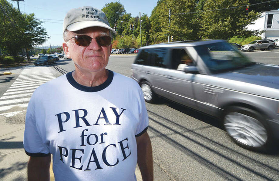Hour Photo / Alex von KleydorffAl Forte makes his way down Westport Avenue in Norwalk on Friday while walking for peace from Boston to Ground Zero in New York City.