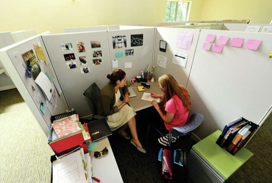 A student works with her Focus teacher in the new Focus room at Winston Prep which is set to hold its grand opening Saturday.Hour photo / Erik Trautmann / (C)2013, The Hour Newspapers, all rights reserved