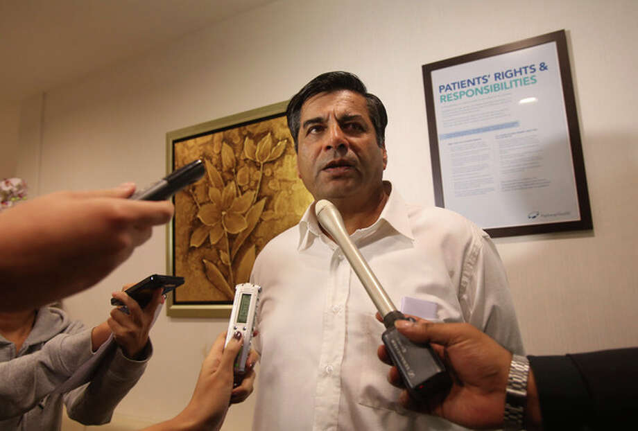 Indian High Commissioner to Singapore, T.C.A. Raghavan speaks to reporters about the death of a young Indian woman who was gang raped, at Mount Elizabeth Hospital late on Saturday Dec. 29, 2012 in Singapore. The woman who was gang-raped and severely beaten on a bus in New Delhi died Saturday at the hospital, after her horrific ordeal galvanized Indians to demand greater protection from sexual violence that impacts thousands of women daily, in homes, streets and public transport, but which often goes unreported. (AP Photo/Wong Maye-E) / AP