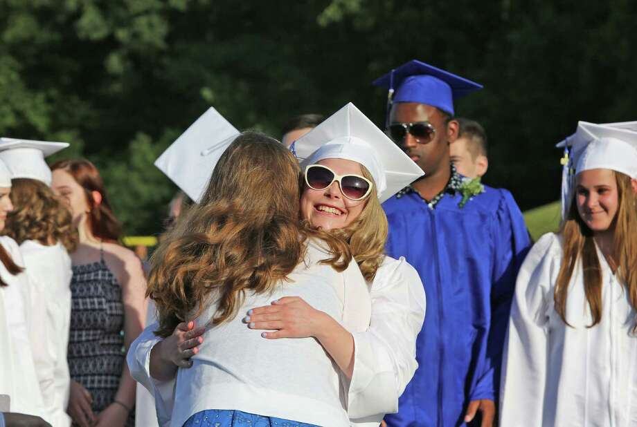 Teacher Keleen Ort hugs her student Molly McFarlans after a musical perfomance during Frank Scott Bunnell High School's fifty sixth annual commencement ceremony June 15, 2016 in Stratford, Conn. Photo: Danielle Robinson Calloway, For Hearst Connecticut Media / Connecticut Post Freelance