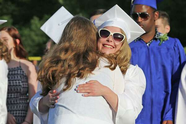 Teacher Keleen Ort hugs her student Molly McFarlans after a musical perfomance during Frank Scott Bunnell High School's fifty sixth annual commencement ceremony June 15, 2016 in Stratford, Conn.