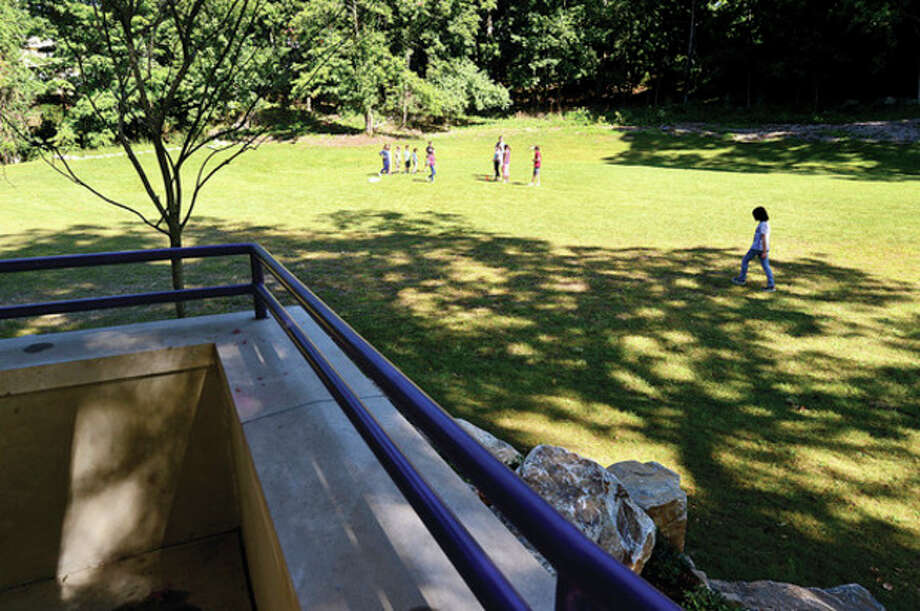 Hour photo / Erik Trautmann Faculty and students take advantage of the outdoor parts of the campus at Winston Prep which is set to hold its grand opening Saturday. / (C)2013, The Hour Newspapers, all rights reserved