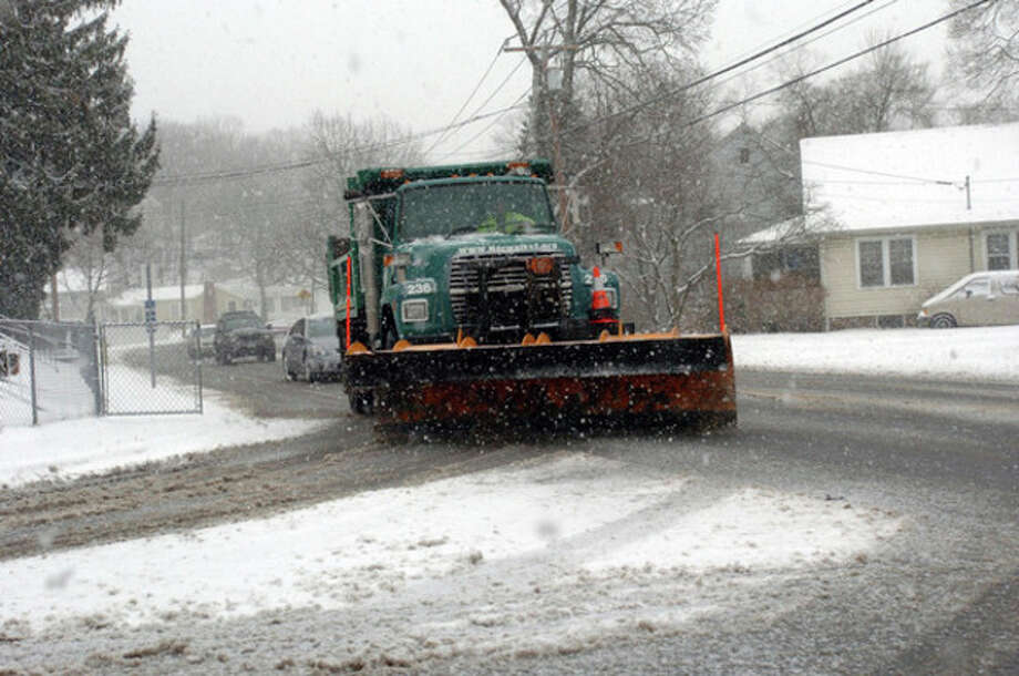 City workers plow Ward Street in Norwalk Wednesday afternoon during the snow storm.Hour Photo / DANIELLE ROBINSON