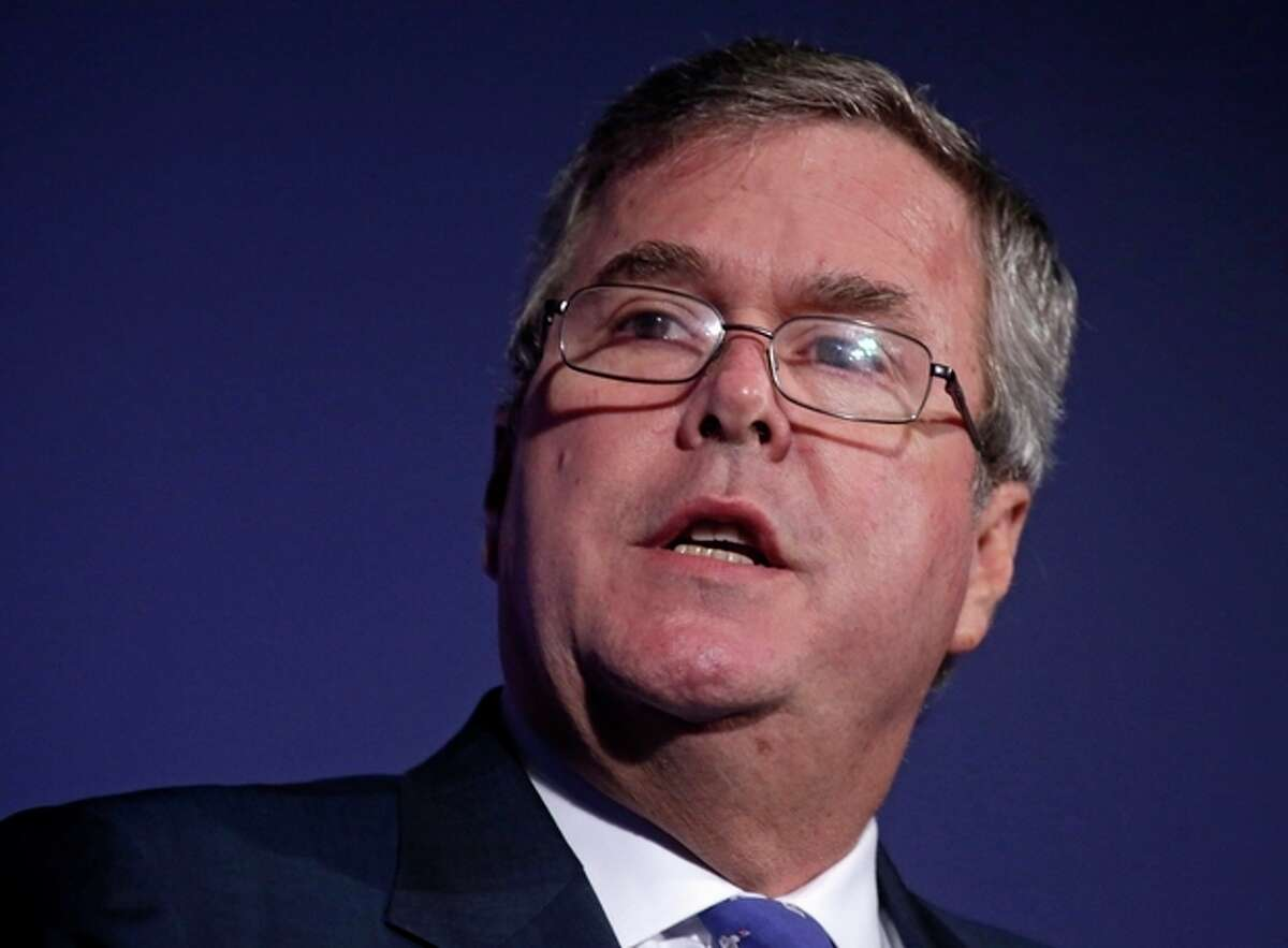 FILE - In this Aug. 9, 2013 file photo, former Florida Gov. Jeb Bush speaks at the American Legislative Exchange Council's 40th annual meeting, in Chicago. Bush said Republicans would be guilty of overplaying their hand if they passed spending measure that did not include money for the 2010 health care law. There is a clear divide forming in the emerging field of potential 2016 presidential candidates, between those say they are making a stand on principle, willing to oppose the law at all costs, and those taking what they call a pragmatic approach, accepting grudgingly the measure as law, and moving forward. (AP Photo/M. Spencer Green, File)