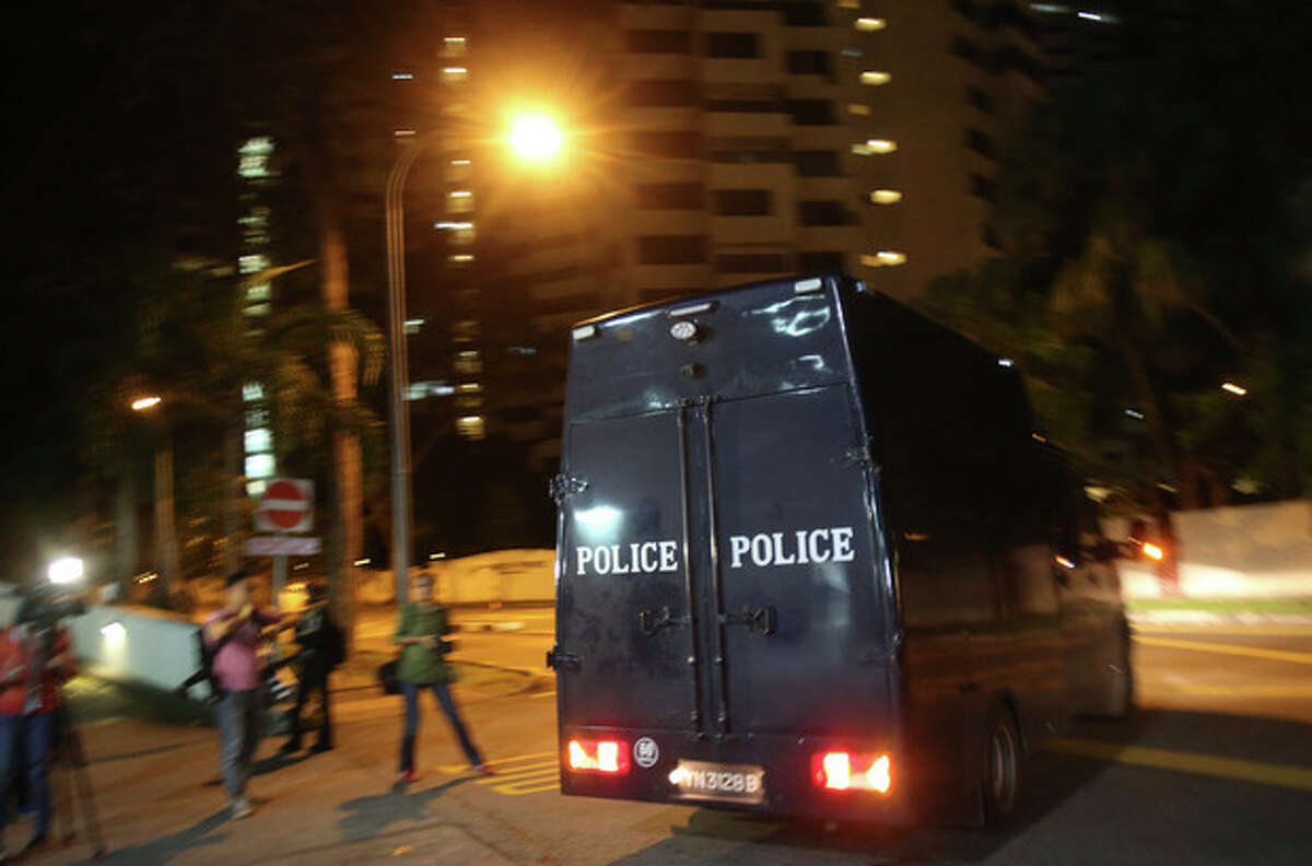 A police hearse leaves Mount Elizabeth Hospital on Saturday Dec. 29, 2012 in Singapore. A young Indian woman who was gang-raped and severely beaten on a bus in New Delhi died Saturday at the hospital, after her horrific ordeal galvanized Indians to demand greater protection from sexual violence that impacts thousands of women daily, in homes, streets and public transport, but which often goes unreported. (AP Photo/Wong Maye-E)