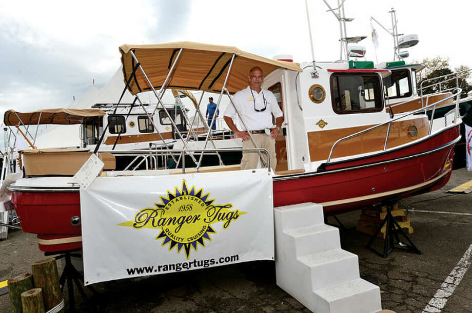 Hour photo / Erik Trautmann Rich Leigh tries to sell leisure tugs like this 21 ft Ranger Tug at the Norwalk Boat Show Saturday at Cove Marina.