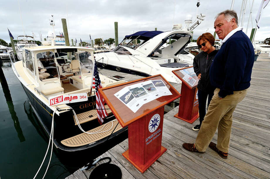 Hour photo / Erik Trautmann Visitors including Howard and Barbara Cherry enjoy the Norwalk Boat Show Saturday at Cove Marina as they look at a MJM 36 ft boat.