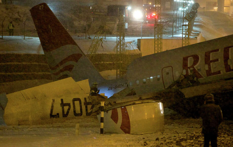 Wreckage of a plane which careered off the runway at Vnukovo Airport in Moscow, Saturday, Dec. 29, 2012. A Tu-204 aircraft belonging to Russian airline Red Wings careered off the runway at Russia's third-busiest airport on Saturday, broke into pieces and caught fire, killing several people. (AP Photo/Ivan Sekretarev) / AP