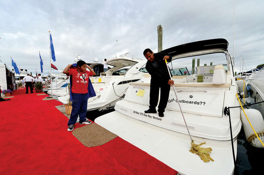 Hour photo / Erik Trautmann Visitors and workers enjoy the Norwalk Boat Show Saturday at Cove Marina.