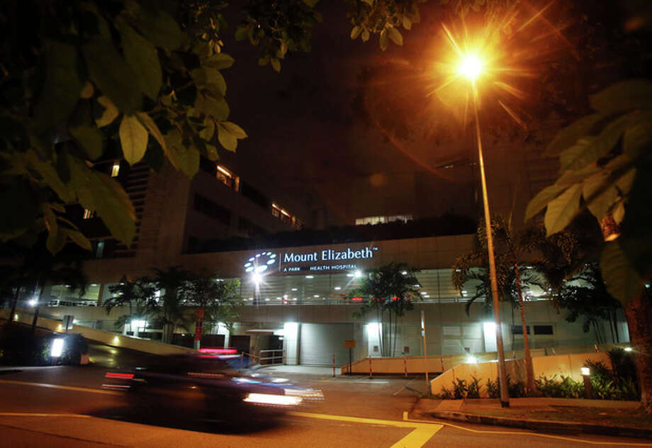 "Vehicles drive past the Mount Elizabeth Hospital in Singapore, late Friday Dec. 28, 2012. After 10 days at a New Delhi hospital, the victim of a gang-rape in New Delhi was flown to Singapore on Thursday for treatment at the Mount Elizabeth hospital. The young woman's condition had ""taken a turn for the worse"" and her vital signs had deteriorated with indications of severe organ failure, said Dr. Kelvin Loh, the chief executive officer of Singapore's Mount Elizabeth hospital. (AP Photo/Wong Maye-E) / AP"