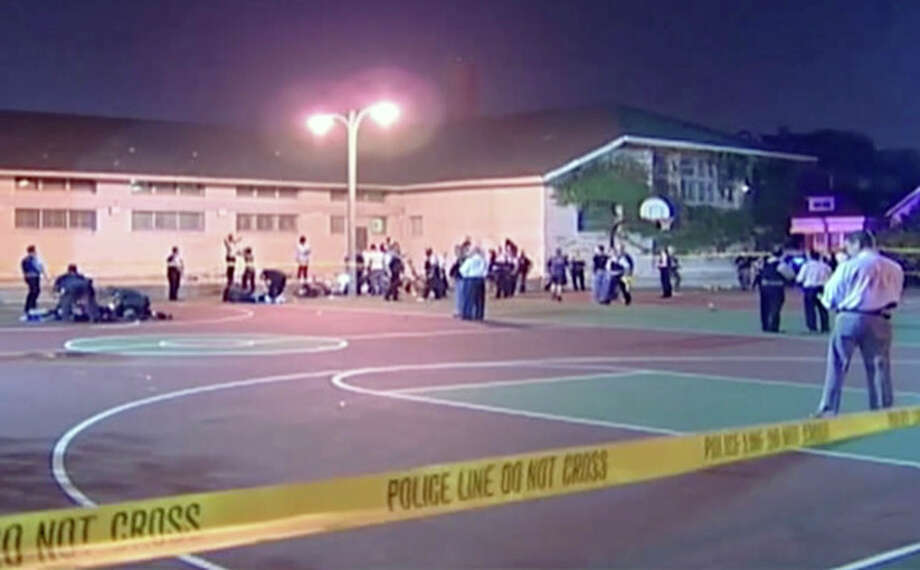 This still frame made from Thursday, Sept. 19, 2013, video provided by Ken Herzlich, shows the scene where a number of people, including a 3-year-old child, were shot Thursday night in a city park in Chicago. Thursday night's attack was the latest violence in a city that has struggled to stop such shootings by increasing police patrols. (AP Photo/Courtesy Ken Herzlich) / Courtesy Ken Herzlich