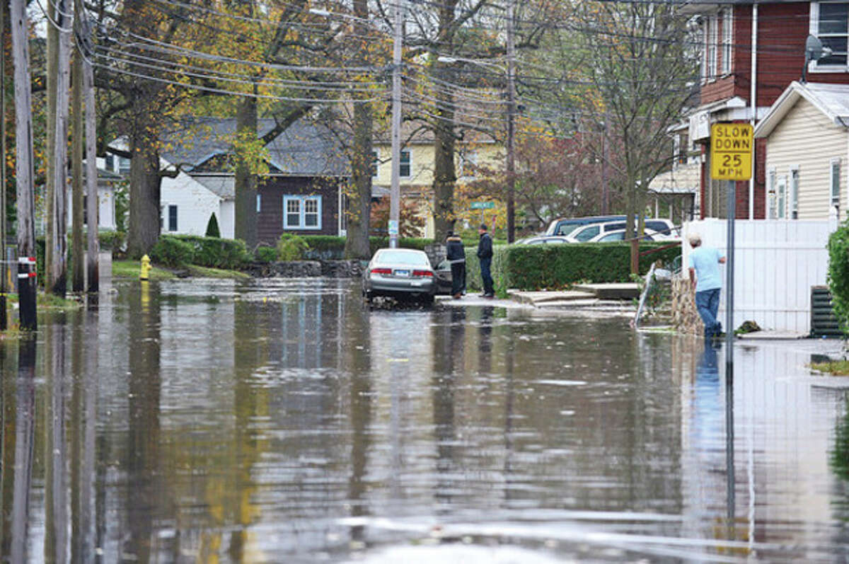 Neighborhoods near the waterfront including Woodward Ave. in Norwalk were inundated with storm surge and high winds bringing down trees and blocking streets. Hour photo / Erik Trautmann