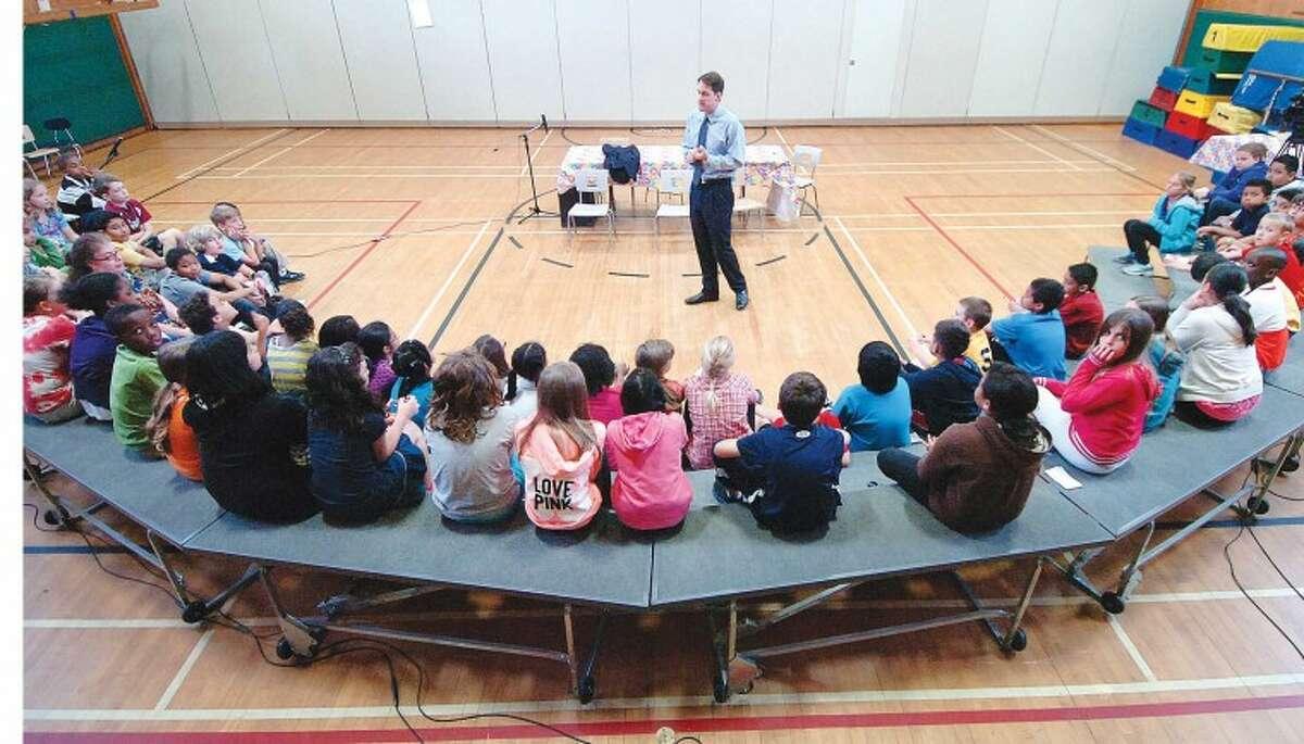 Hour Photo/ Alex von Kleydorff. Jim Himes answers some questions from three fourth grade classes at Fox Run School