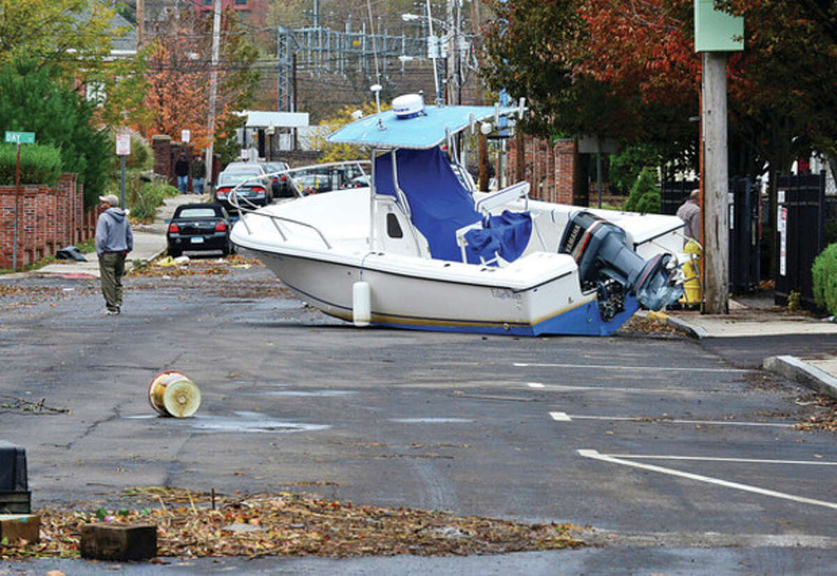 Neighborhoods near the waterfront including Water St in South Norwalk in Norwalk were inundated with strom surge and high winds bringing down trees and blocking streets. Hour photo / Erik Trautmann