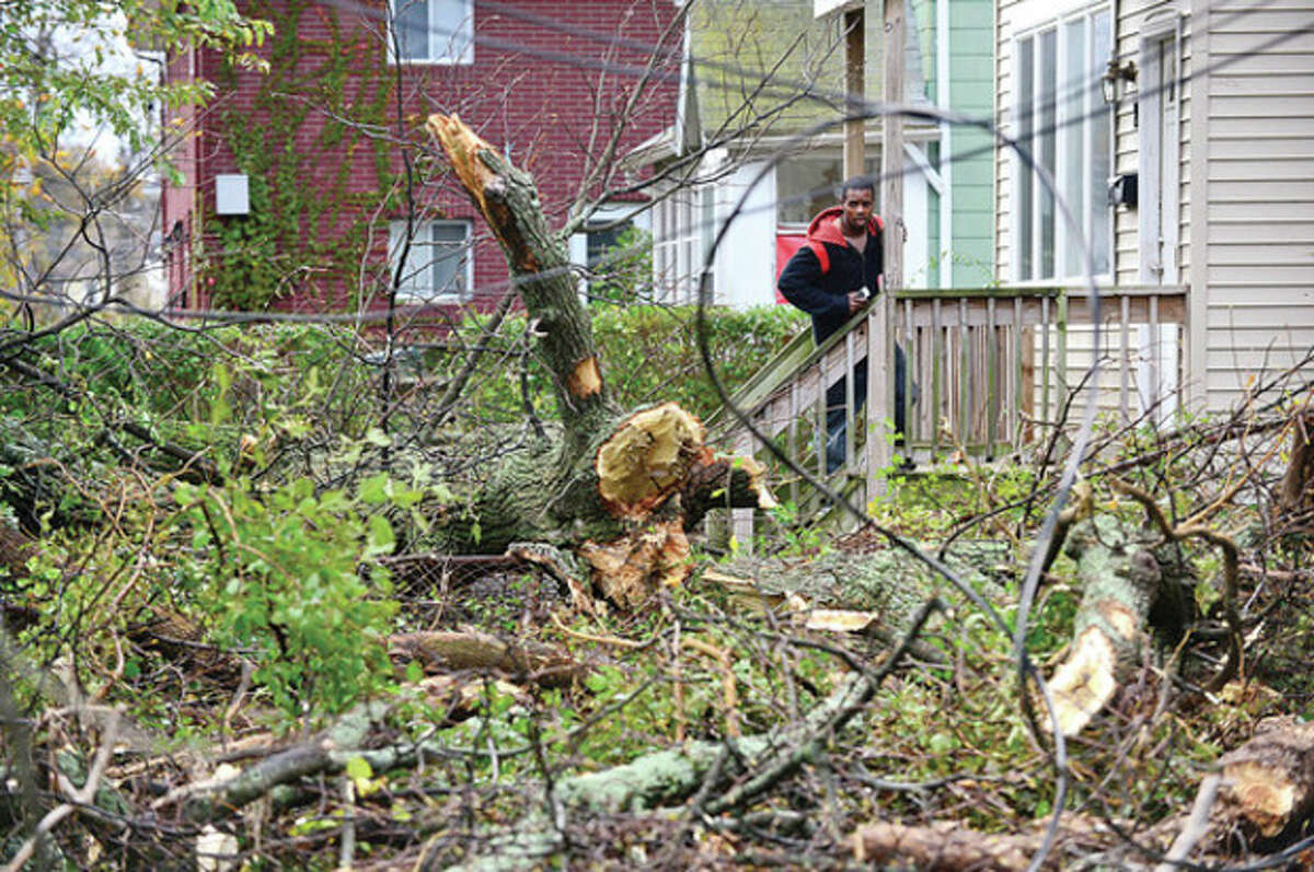 Neighborhoods near the waterfront including Woodward Ave in Norwalk were inundated with strom surge and high winds bringing down trees and blocking streets. Hour photo / Erik Trautmann