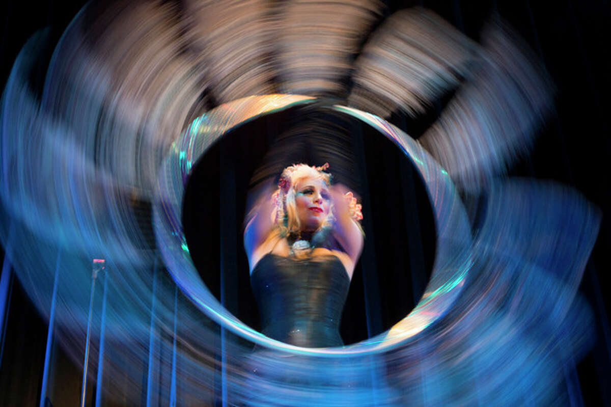 Burlesque artist Anna the Hulagan of Britain performs with her hula hoop during the Odd Night, the second show of the first international Berlin Burlesque Festival in Berlin on Friday, Sept. 20, 2013. The four-day festival including three different evening shows and different workshops hosts some 36 international burlesque artists. (AP Photo/Gero Breloer, File)