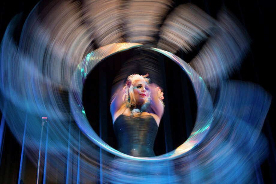 Burlesque artist Anna the Hulagan of Britain performs with her hula hoop during the Odd Night, the second show of the first international Berlin Burlesque Festival in Berlin on Friday, Sept. 20, 2013. The four-day festival including three different evening shows and different workshops hosts some 36 international burlesque artists. (AP Photo/Gero Breloer, File) / AP