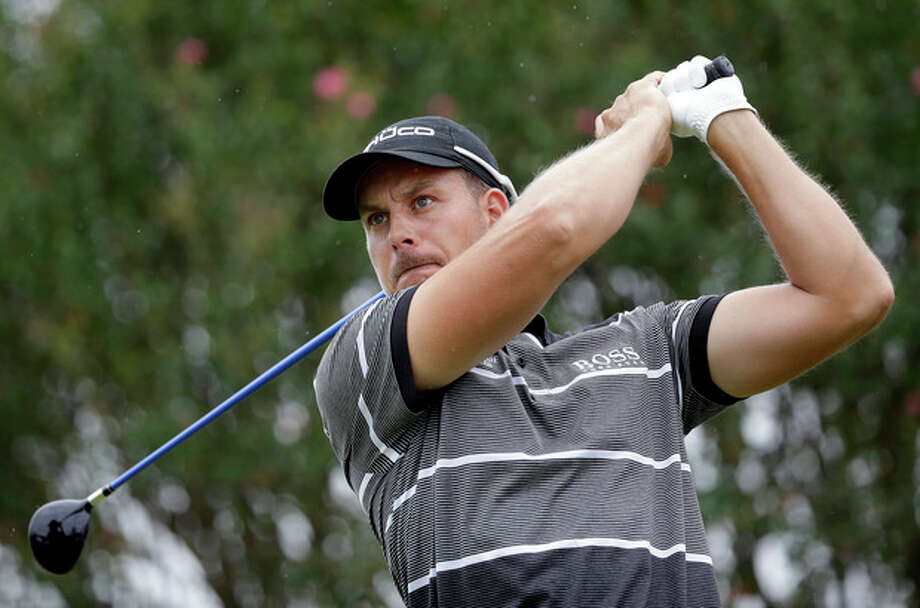 Henrik Stenson, of Sweden, tees off the seventh hole during the third round of play in the Tour Championship golf tournament at East Lake Golf Club, in Atlanta, Saturday, Sept. 21, 2013. (AP Photo/David Goldman) / AP
