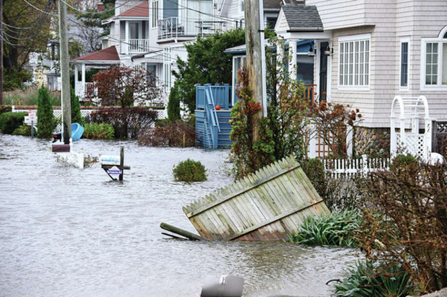 Westport neighborhoods near the waterfront were inundated with storm surge and high winds bringing down trees and blocking streets.Hour photo / Erik Trautmann / (C)2012, The Hour Newspapers, all rights reserved