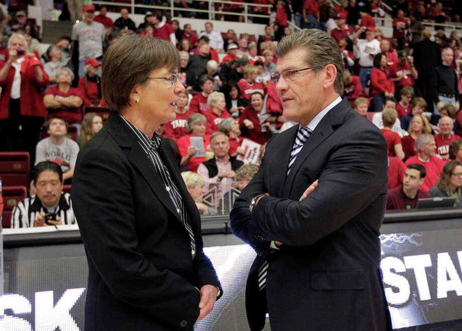 CORRECST SPELLING OF COACHES NAMES - Connecticut head coach Geno Auriemma, right, talks with Stanford head coach Tara VanDerveer before the start of their NCAA college basketball game in Stanford, Calif., Saturday, Dec. 29, 2012. (AP Photo/Tony Avelar) / FR155217 AP