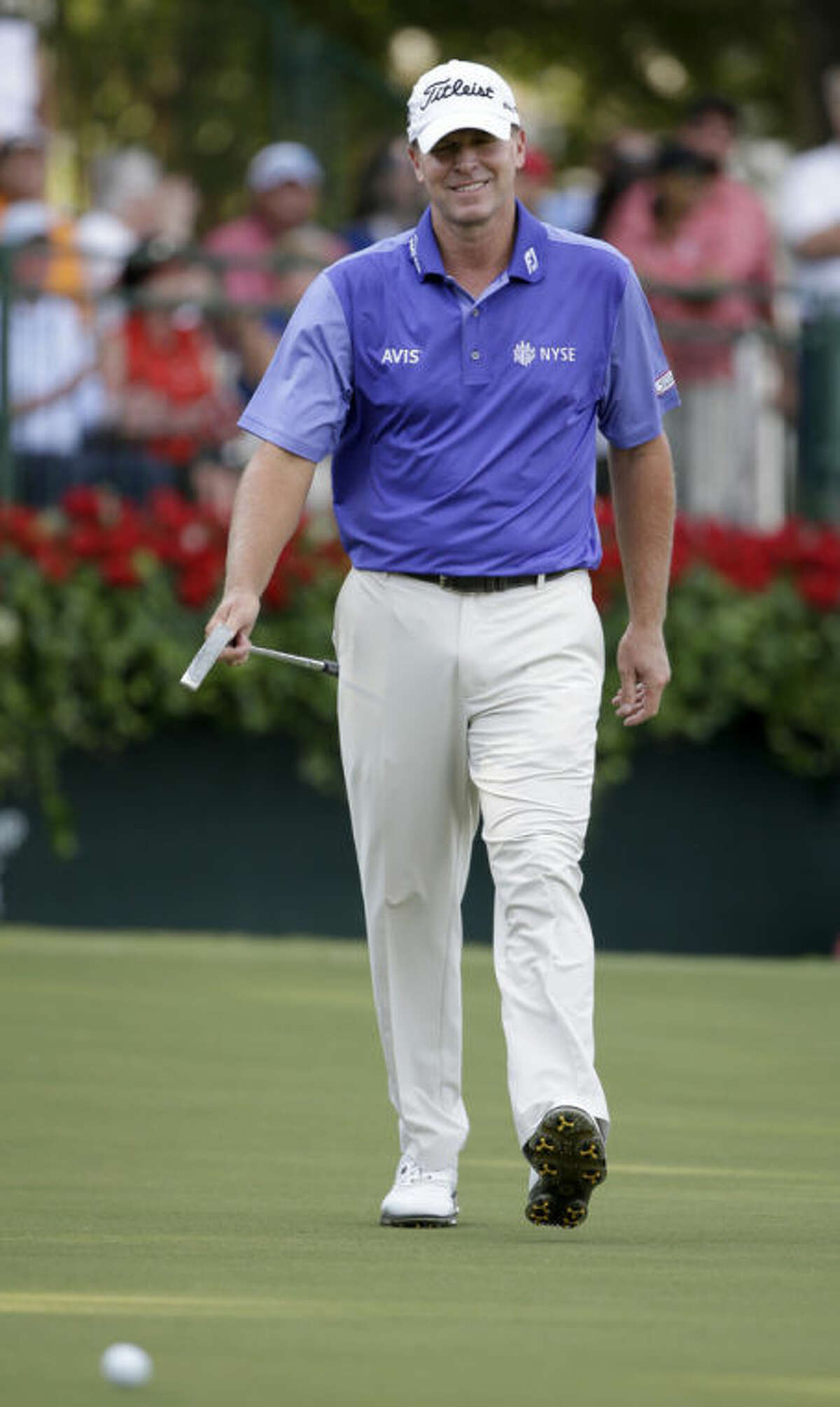 Steve Stricker smiles as he approaches his ball to putt on the 18th hole during the second round of the Tour Championship golf tournament at East Lake Golf Club in Atlanta, Friday, Sept. 20, 2013. (AP Photo/David Goldman)