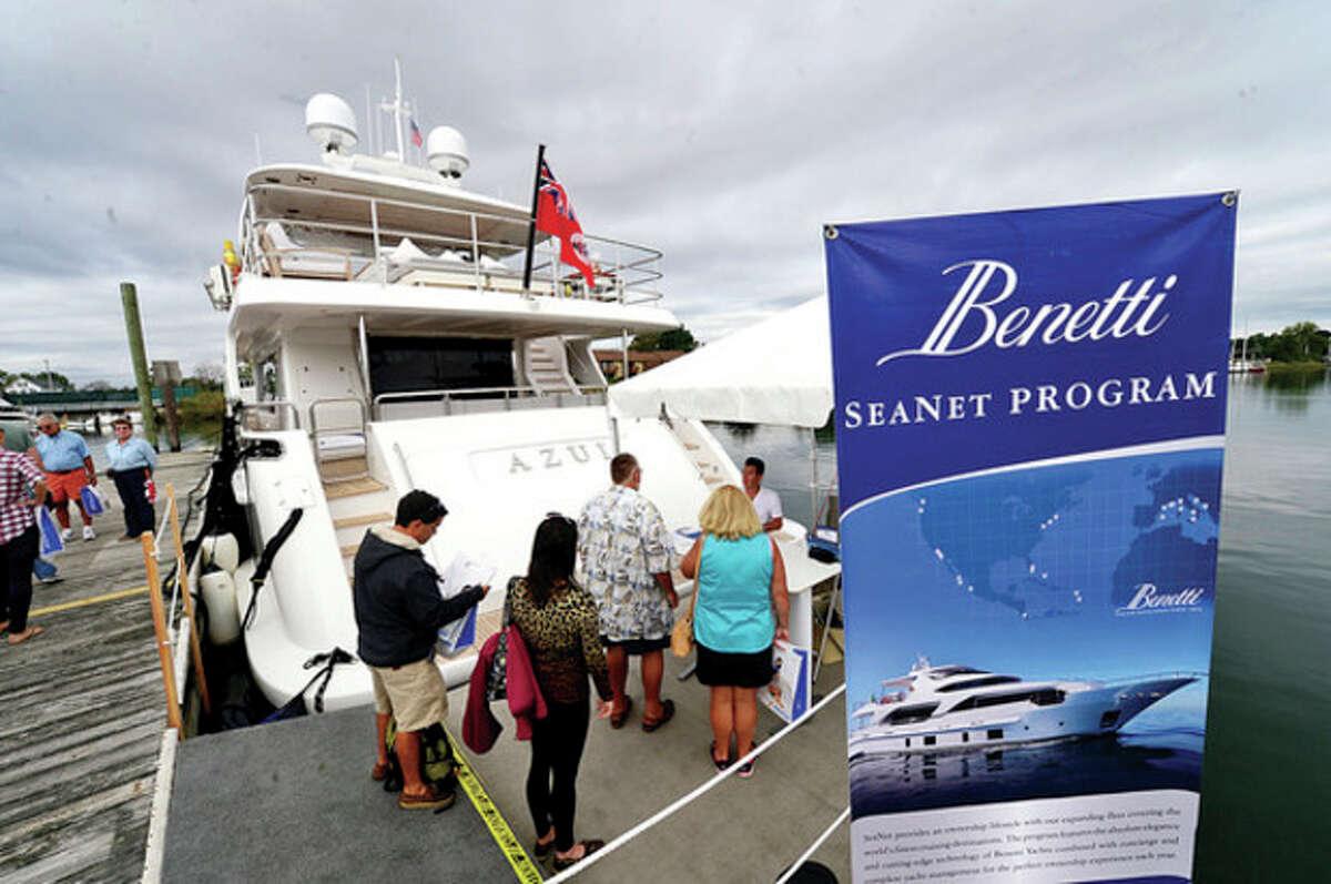 Hour photo / Erik Trautmann Visitors enjoy the Norwalk Boat Show Saturday at Cove Marina.