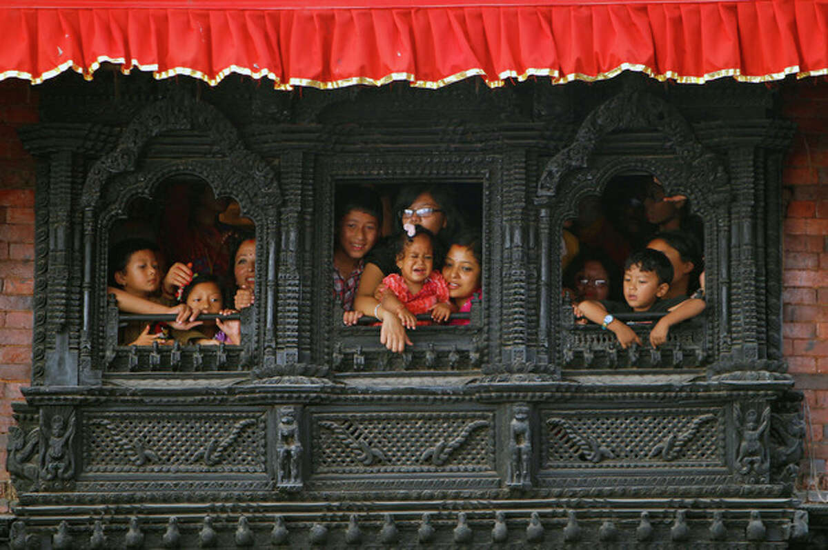 Devotees watch celebrations to mark the week-long Indra Jatra festival in Katmandu, Nepal, Wednesday, Sept. 18. The festival marks the end of the monsoon season and is celebrated by both Hindus and Buddhists. (AP Photo/Niranjan Shrestha, File)