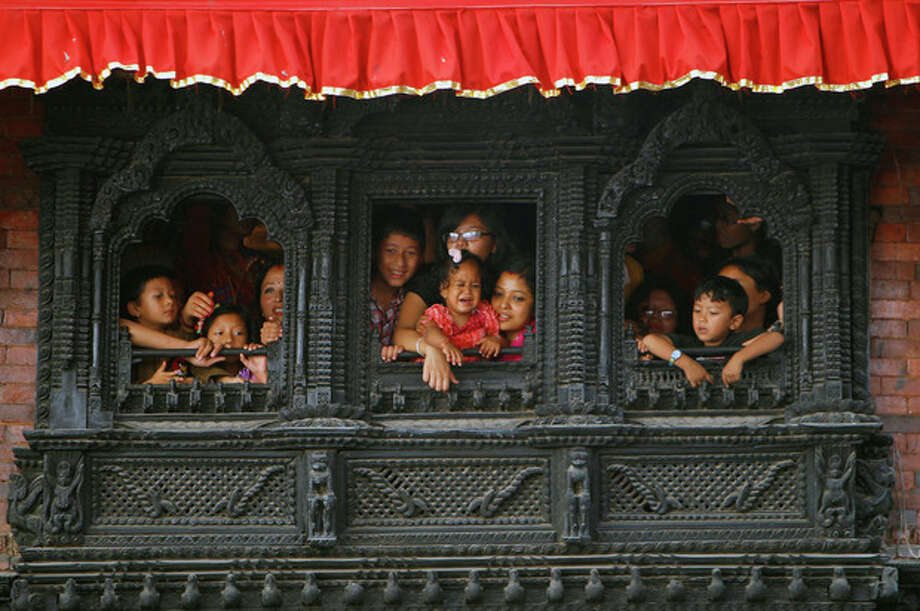 Devotees watch celebrations to mark the week-long Indra Jatra festival in Katmandu, Nepal, Wednesday, Sept. 18. The festival marks the end of the monsoon season and is celebrated by both Hindus and Buddhists. (AP Photo/Niranjan Shrestha, File) / AP