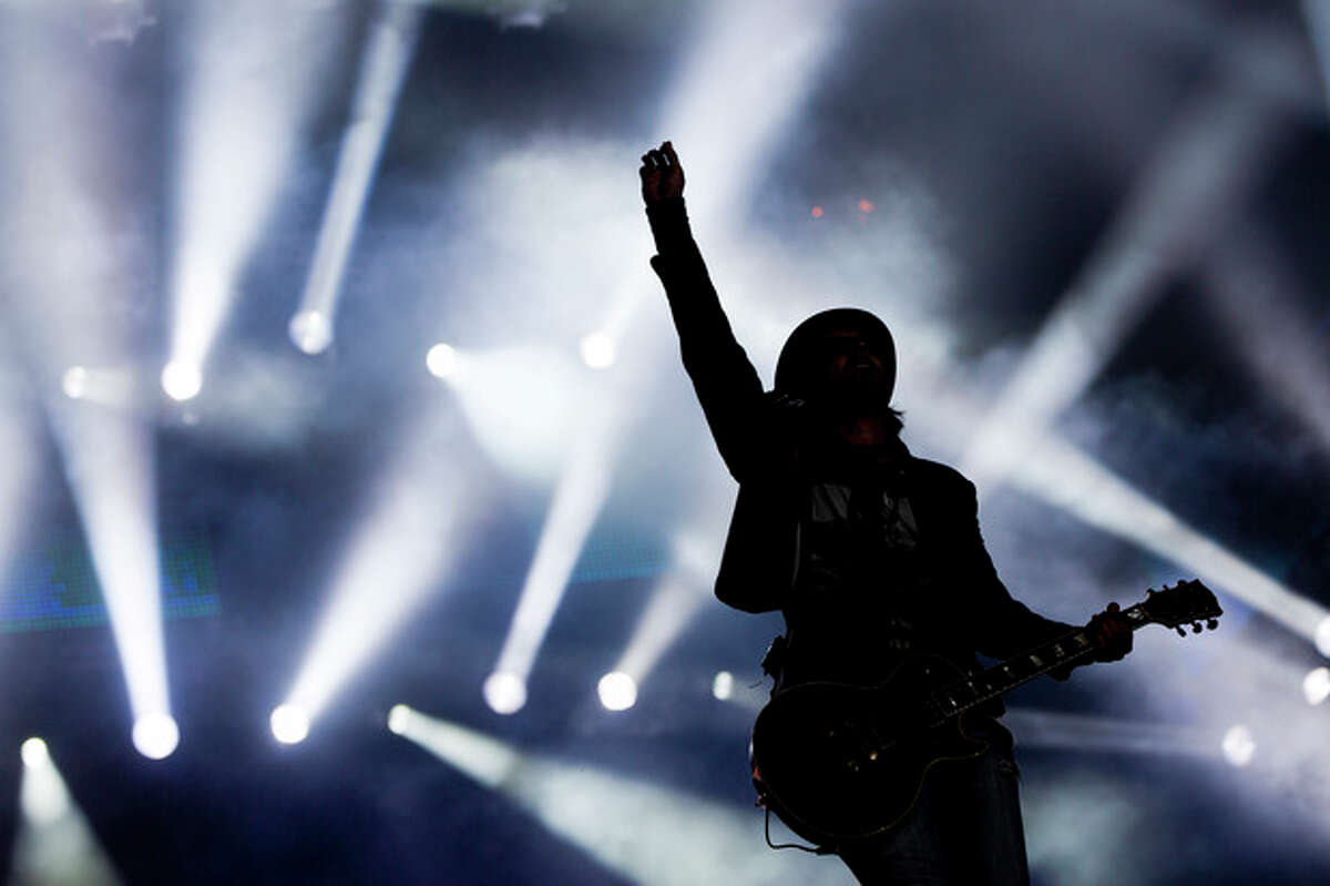 Guitar player Marco Tulio of Brazilian band Jota Quest performs during the Rock in Rio music festival in Rio de Janeiro on Sunday, Sept. 15, 2013. The week-long festival will feature a list of headliners including Muse, Justin Timberlake, Metallica, Bon Jovi and Bruce Springsteen. (AP Photo/Felipe Dana, File)