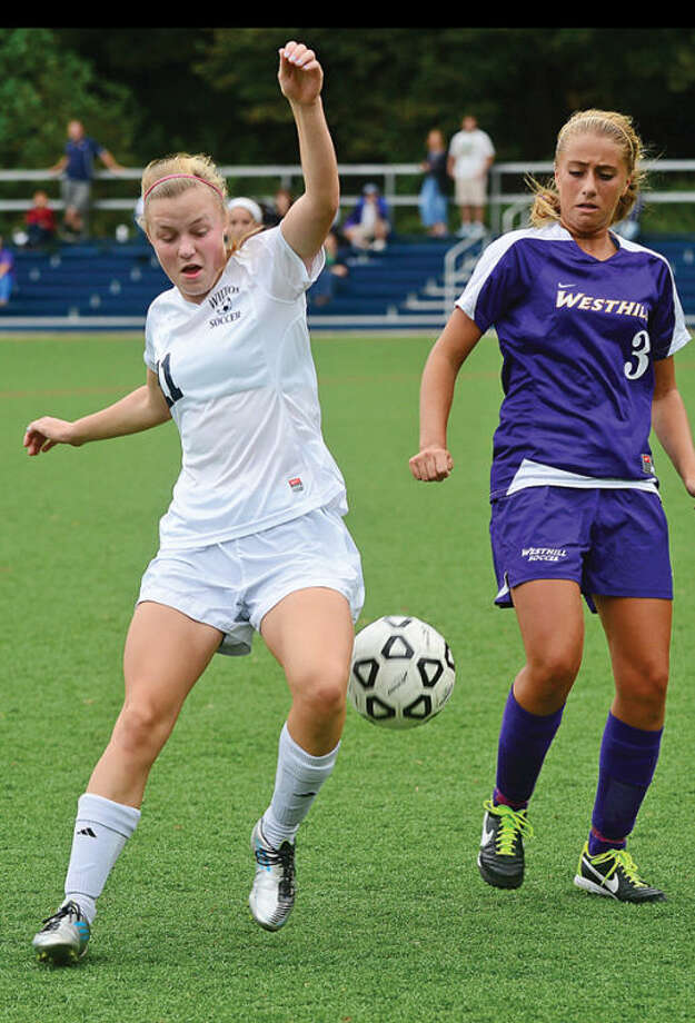 Wilton's #11 battles against Westhill's #3 Rebecca Shaulson in their game Saturday.