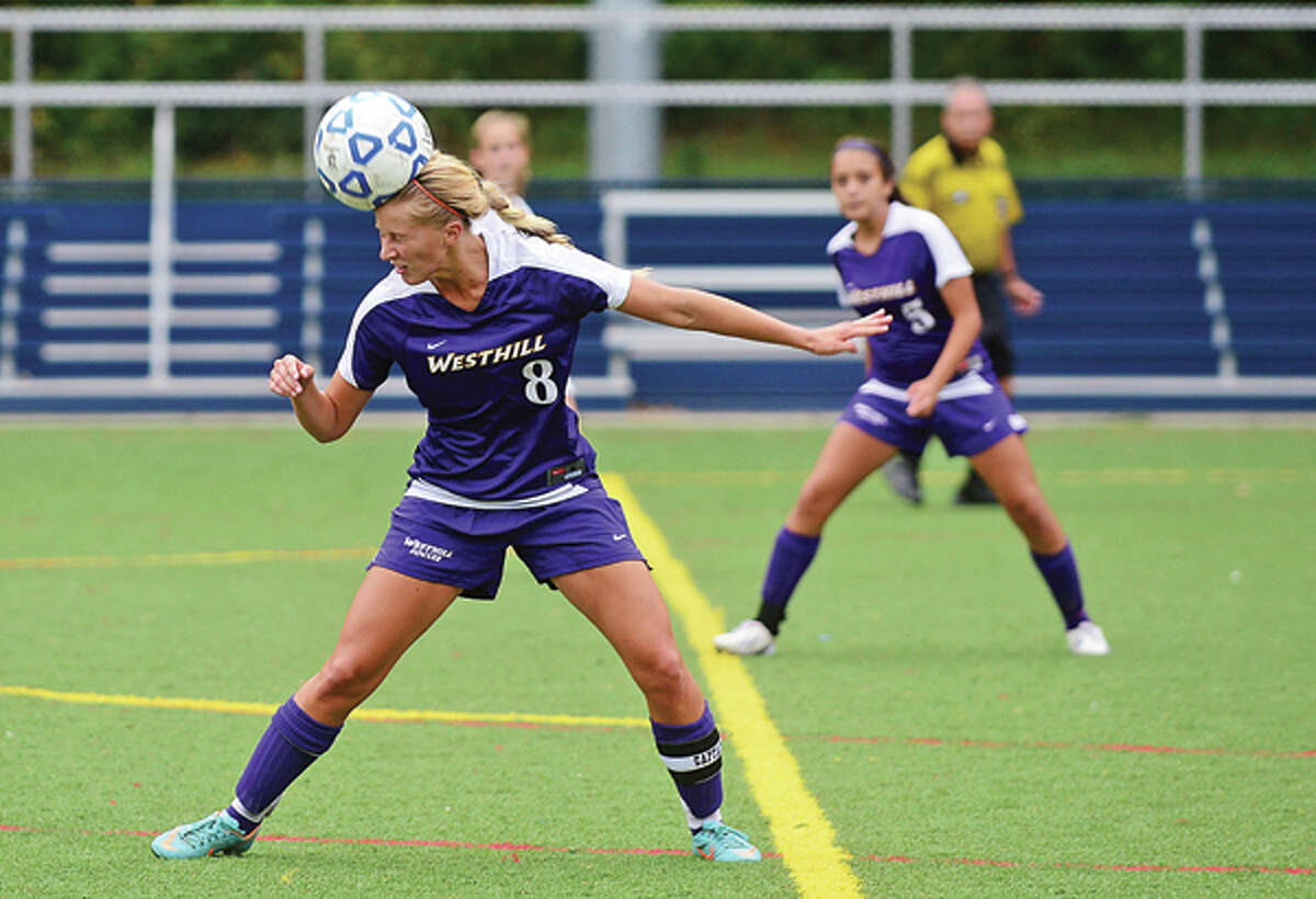 #8 for Westhill heads the ball in their game against Wilton Saturday.