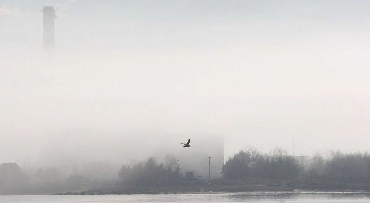 Hour Photo/ Alex von Kleydorff. Fog surrounds the Manresa Power Plant in Norwalk on a warm first day of spring