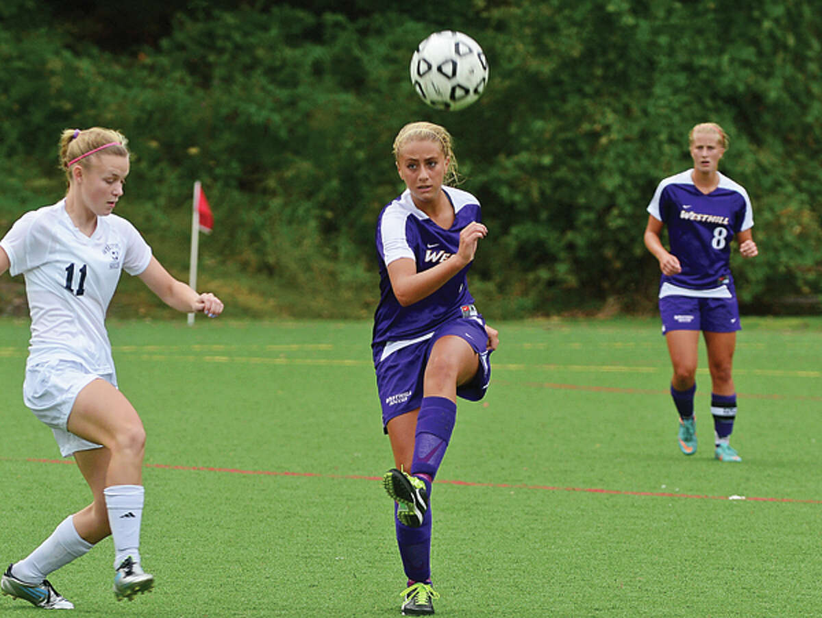 #21 for Westhill Christine Belmonte kicks the ball in their game against Wilton Saturday.