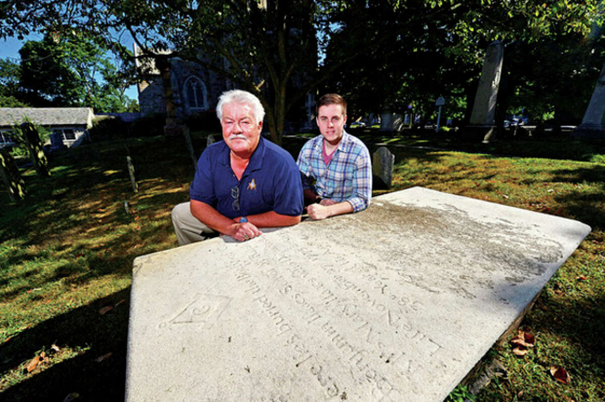 Hour photos / Erik Trautmann Ed Isaacs and his son, Chris Isaacs, tracked down their direct ancestor, Ralph Isaacs, who came to Norwalk from Fairfield in 1725 with his wife, Mary Rumsey, and, along with three others, staked the ground for the future St. Paul's Church on the Green in 1737. Isaacs has traced his lineage to Samuel Isaacs, who had at least two sons who fought in the Revolutionary War in New York. Below, left and right, Isaacs shows mementoes.