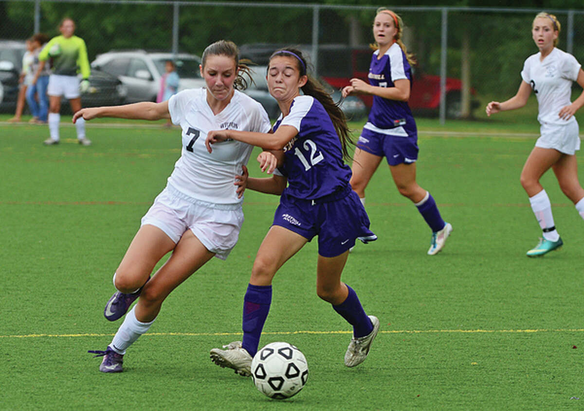 #7 for Wilton Haley English battle for the ball against Westhill's #12 during the game Saturday.