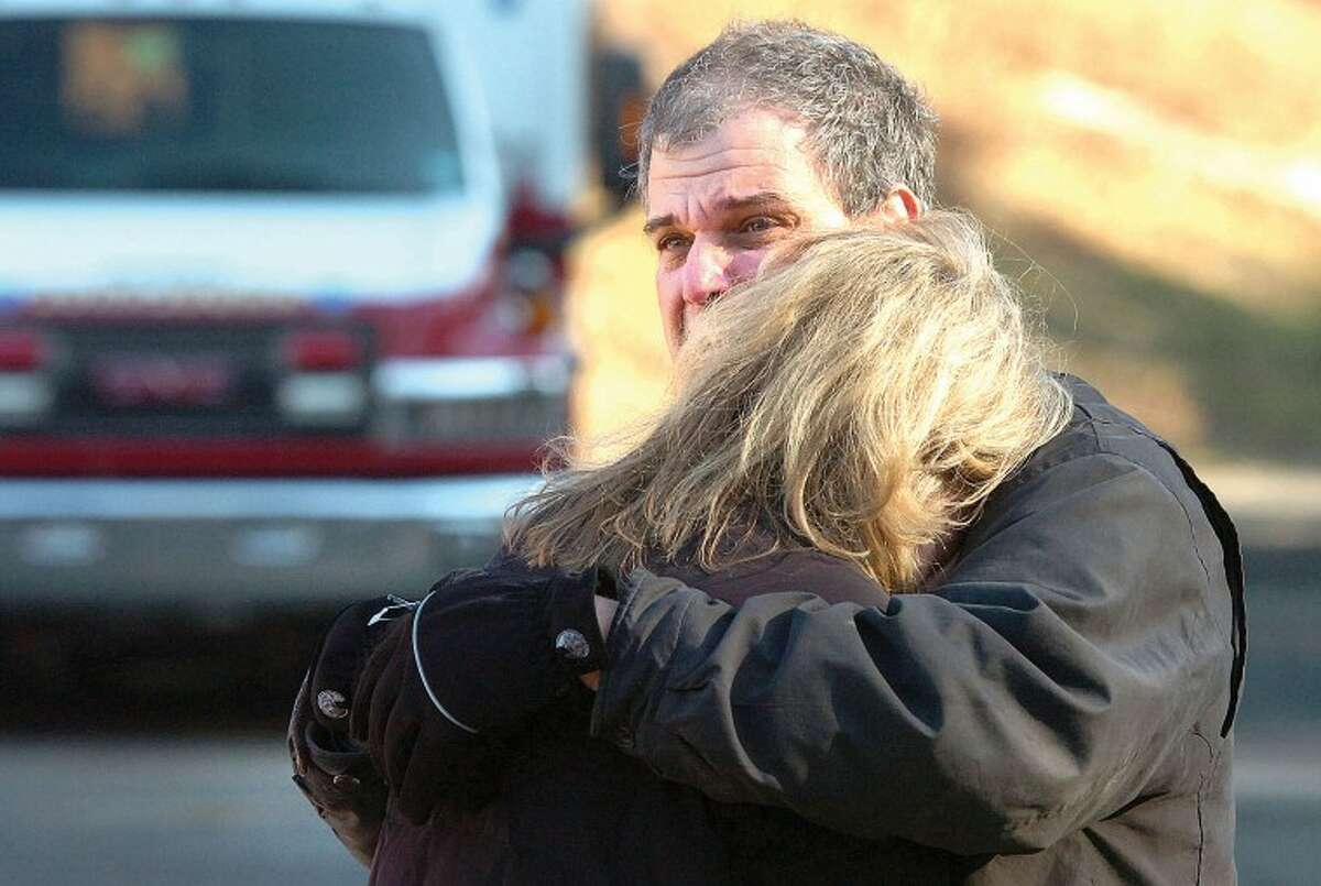 Hour Photo/Alex von Kleydorff. People react near the scene of a mass shooting at Sandy Hook School in Newtown Ct on Friday morning