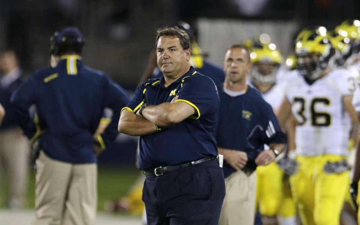 Michigan head coach Brady Hoke watches his players during the second quarter of an NCAA college football game against Connecticut, Saturday, Sept. 21, 2013, in East Hartford, Conn. (AP Photo/Charles Krupa)
