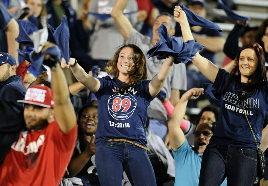 Connecticut fans cheer before an NCAA college football game against Michigan at Rentschler Field, Saturday, Sept. 21, 2013, in East Hartford, Conn. (AP Photo/Jessica Hill)