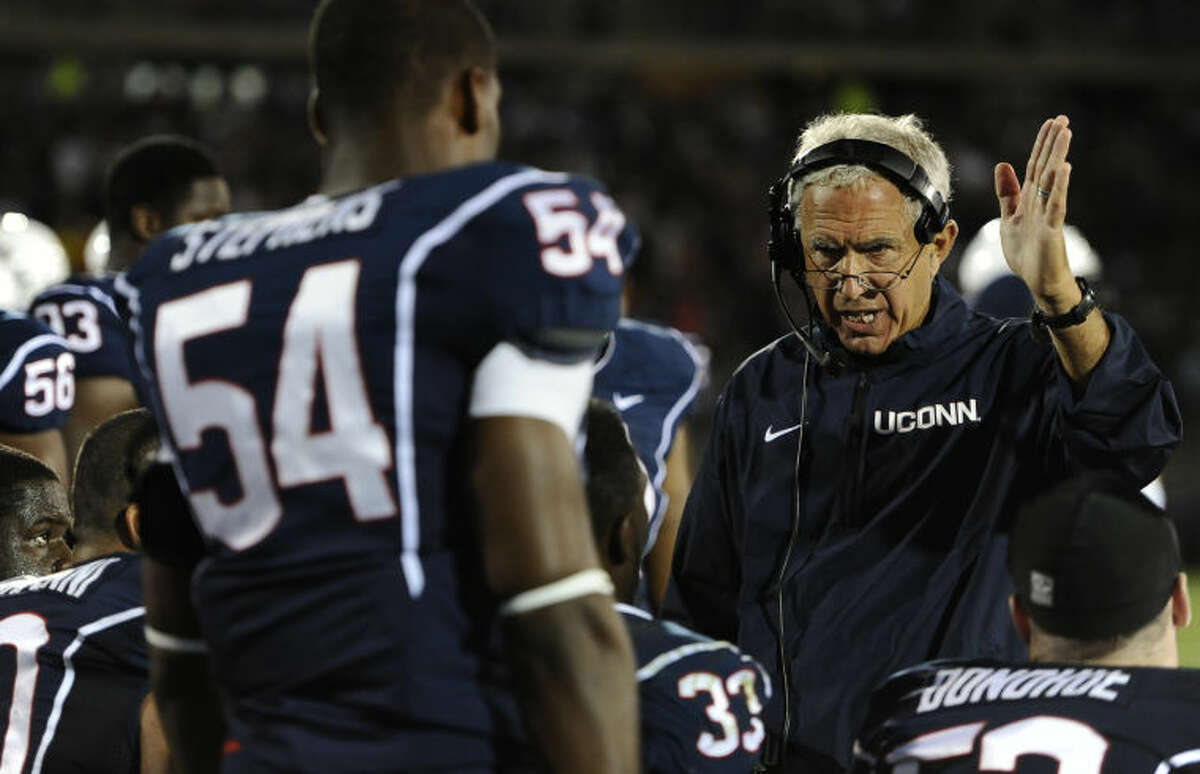 Connecticut head coach Paul Pasqualoni, right, gestures to his team during the second half of an NCAA college football game against Michigan at Rentschler Field, Saturday, Sept. 21, 2013, in East Hartford, Conn. (AP Photo/Jessica Hill)
