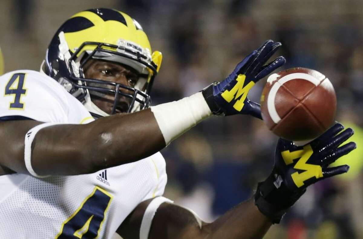 Michigan linebacker Cameron Gordon makes a catch before an NCAA college football game against Connecticut, Saturday, Sept. 21, 2013, in East Hartford, Conn. (AP Photo/Charles Krupa)