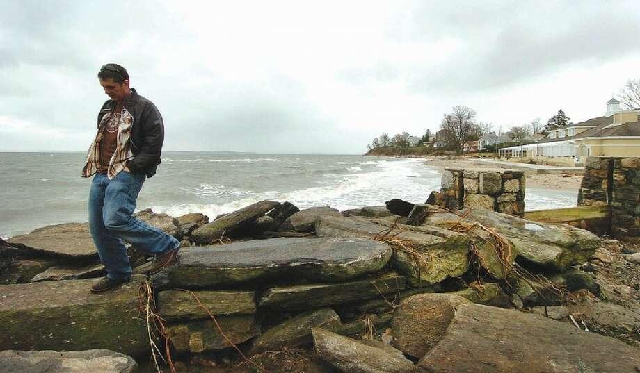 Hour Photo Alex von Kleydorff; People look at storm damage off Sea Beach rd in stamford on Monday