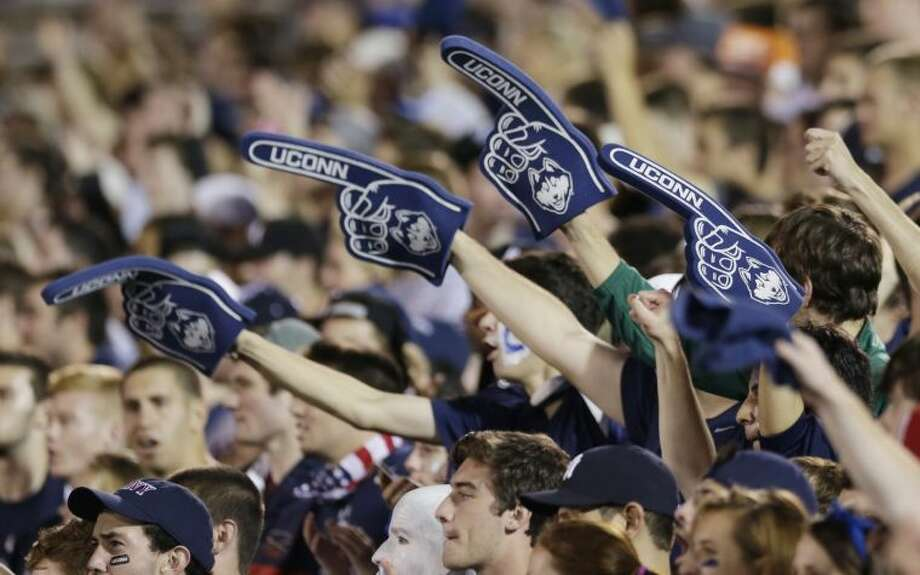 Connecticut fans during the second quarter of an NCAA college football game against Michigan, Saturday, Sept. 21, 2013, in East Hartford, Conn. (AP Photo/Charles Krupa)