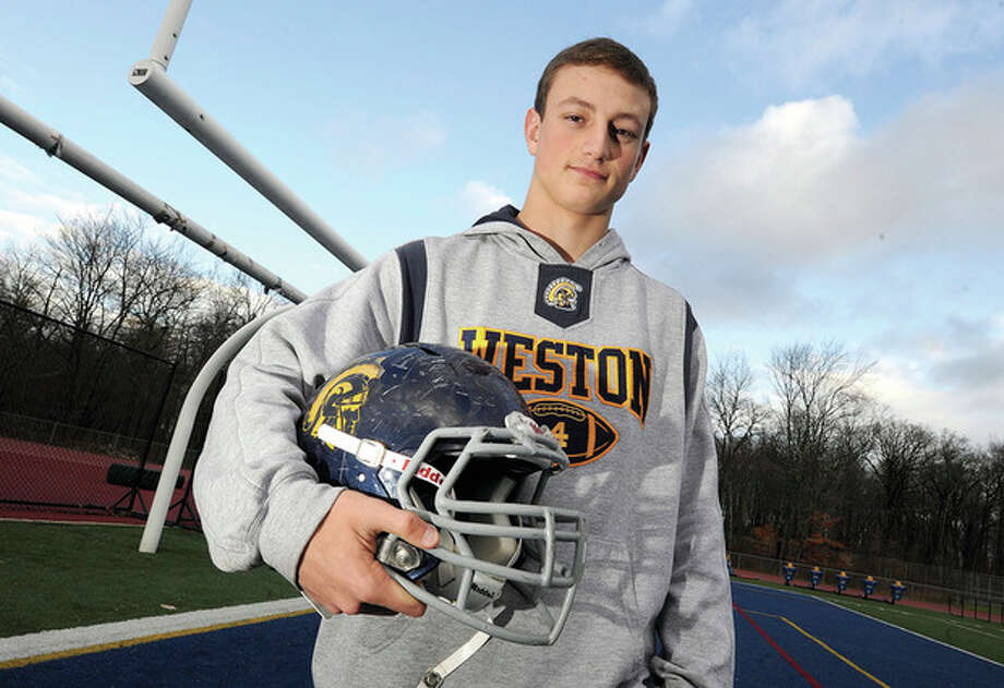 Hour photo/Matthew VinciWeston's Tyler Hassett may be small in stature, but the senior came up big when it counted, leading the Trojans into the state playoffs for the first time in more than 20 years. A two-way performer, Hassett has been selected as the MVP on The Hour's All-Area football team.
