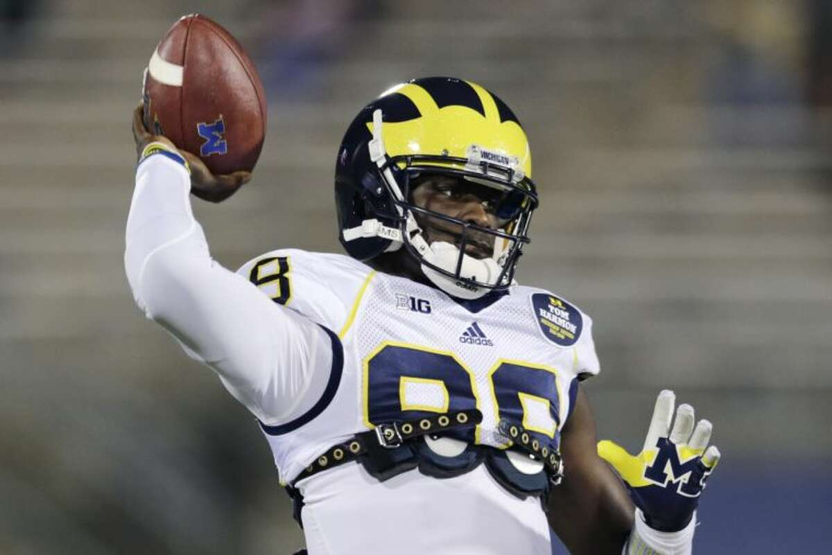 Michigan quarterback Devin Gardner (98) warms up before an NCAA college football game against Connecticut, Saturday, Sept. 21, 2013, in East Hartford, Conn. (AP Photo/Charles Krupa)