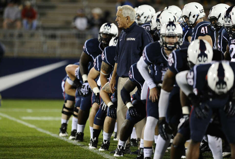 Connecticut head coach Paul Pasqualoni, center, watches his team run drills before an NCAA college football game against Connecticut at Rentschler Field, Saturday, Sept. 21, 2013, in East Hartford, Conn. (AP Photo/Jessica Hill)