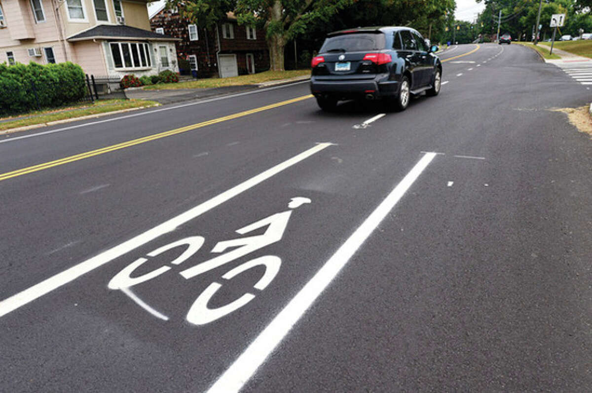 Hour photo / Erik Trautmann New bike lanes on Strawberry Hill Avenue, while welcomed, have perplexed motorists and bicyclists alike.