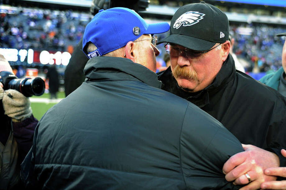 Philadelphia Eagles head coach Andy Reid, right, shakes hands with New York Giants head coach Tom Coughlin after an NFL football game, Sunday, Dec. 30, 2012, in East Rutherford, N.J. The Giants won 42-7. (AP Photo/Bill Kostroun) / FR51951 AP